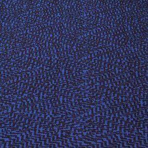 Strickstoff mit Zick-Zack-Muster in blau und schwarz